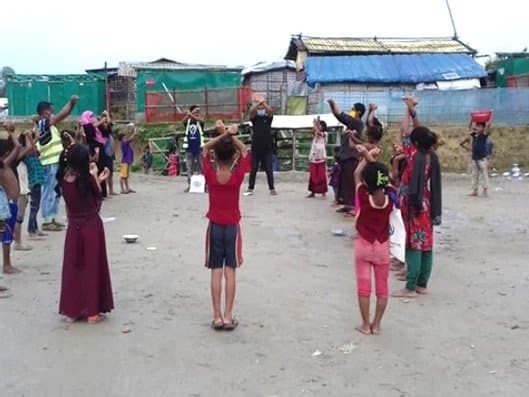 children dancing at a clown event