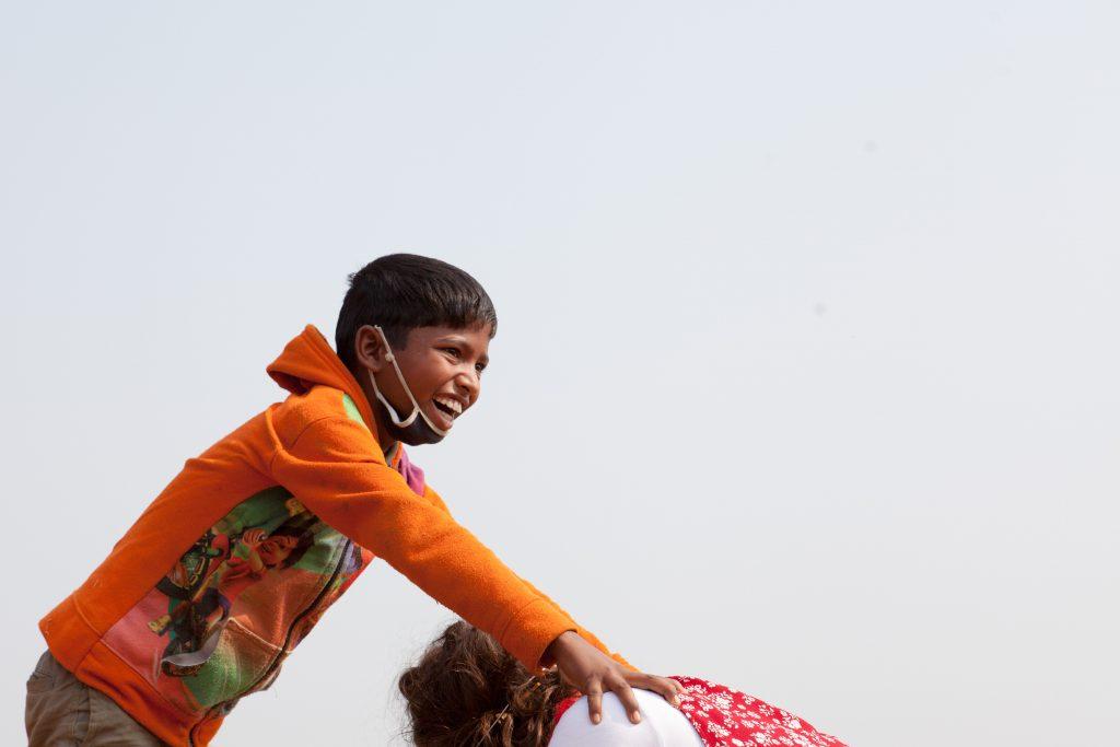 boy climbing on the back of a clown