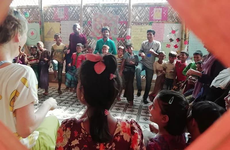 children dancing at a clown event